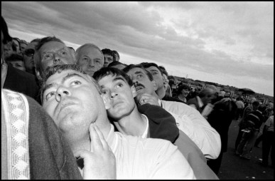 IRELAND. Galway. 1996. Watching the horses on a racetrack television screen. 1996.