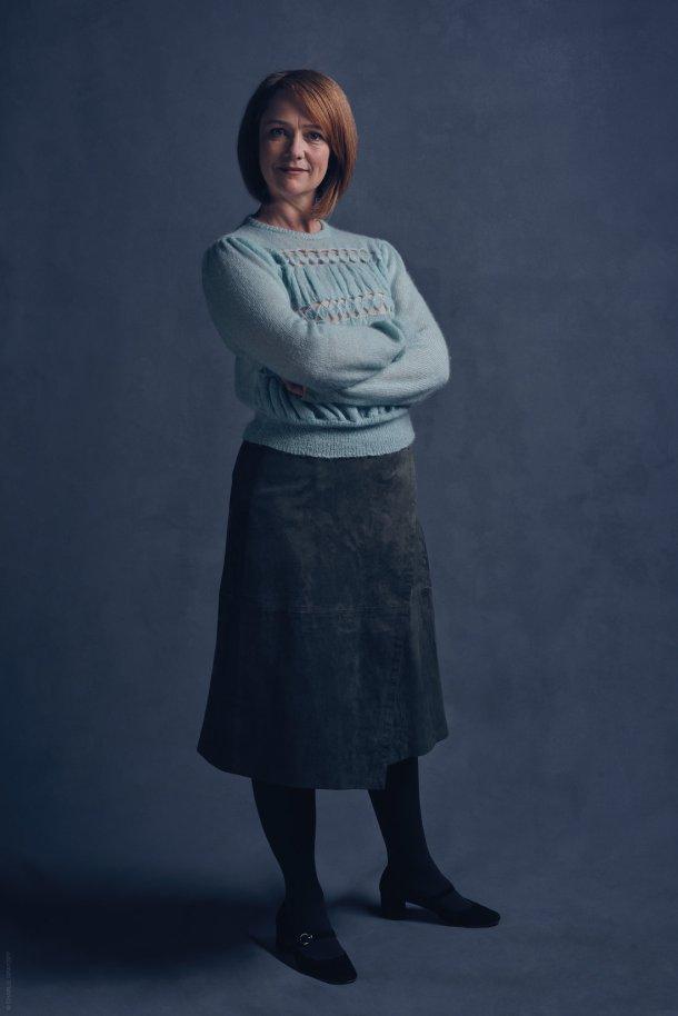 Poppy Miller como Ginny. <a href=