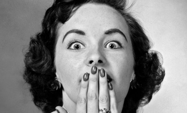 woman-with-hand-over-her-mouth-2