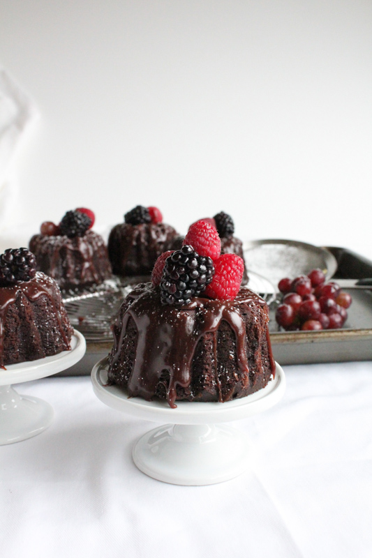 Mini Chocolate Bundt Cakes, topped with chocolate ganache and fresh berries. Doesn't get any better than this!