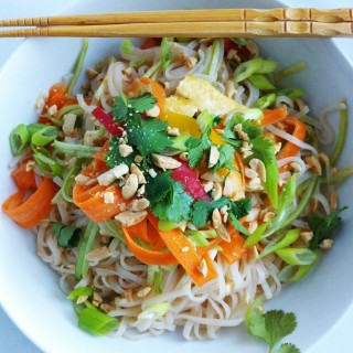 Fresh Asian Rice Noodle Bowl! Raw veggies, on top of seasoned rice noodles with limes, cilantro and crushed peanuts! So easy!