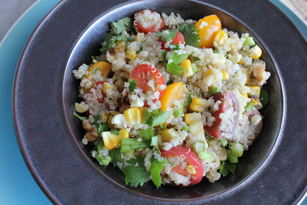 Bright, light and flavorful Summer Quinoa Salad! I love eating mini heirloom tomatoes this way!