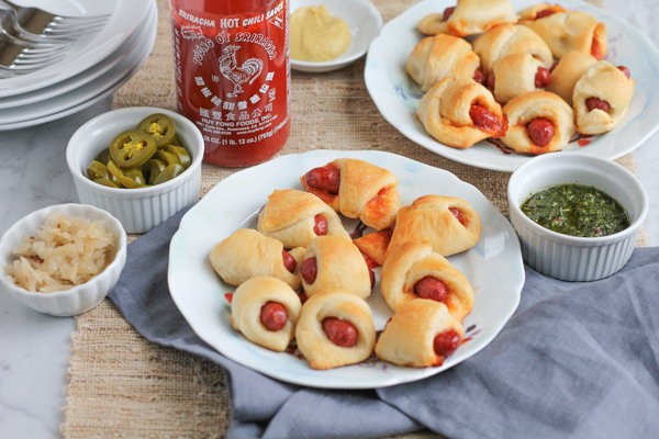 Honey Sriracha Pigs in a Blanket!!! So good and SO EASY to make! These are perfect for a party or game day!