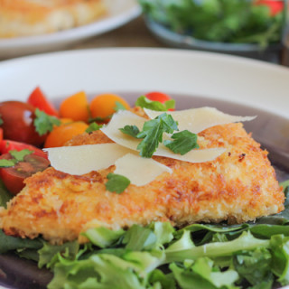Spicy Chicken Milanese. Breaded and pan-fried chicken cutlets topped with a juicy tomato salad and salty slivers of Parmesan cheese.