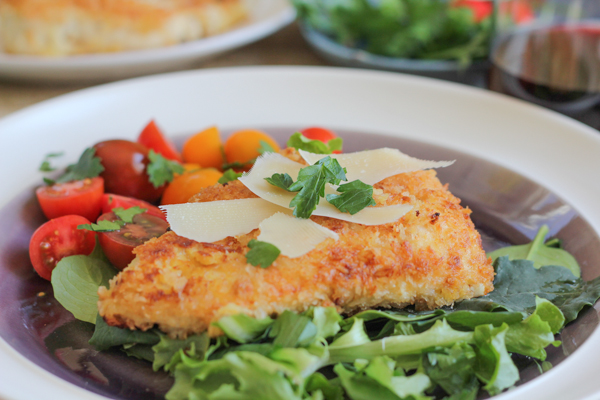 Spicy Chicken Milanese! For a super-quick and delicious chicken dinner, these cutlets are breaded and pan-fried, then topped with a juicy tomato salad and salty slivers of Parmesan cheese.