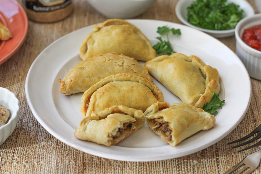 Baked Empanadas, three ways! Traditional ground beef, bratwurst & sauerkraut and mac and cheese empanadas!! Serve these at your next dinner party or brunch!
