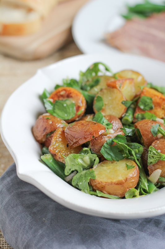 Roasted Potato Salad with Parsley and Arugula. A new and fresh way to make potato salad! Roasted potatoes with green beans, parsley and arugula, mixed in a lemon, Dijon mustard and honey dressing. So good!