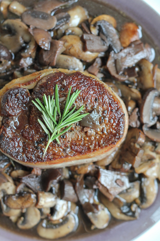 Filet Mignon with Mushrooms and Pinot Noir Sauce!!! And it's wrapped in bacon! This filet mignon is unforgettable! Try the recipe!