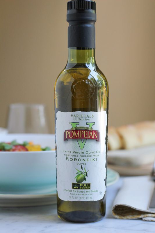 A bottle of olive oil for Summer Caprese pasta salad.