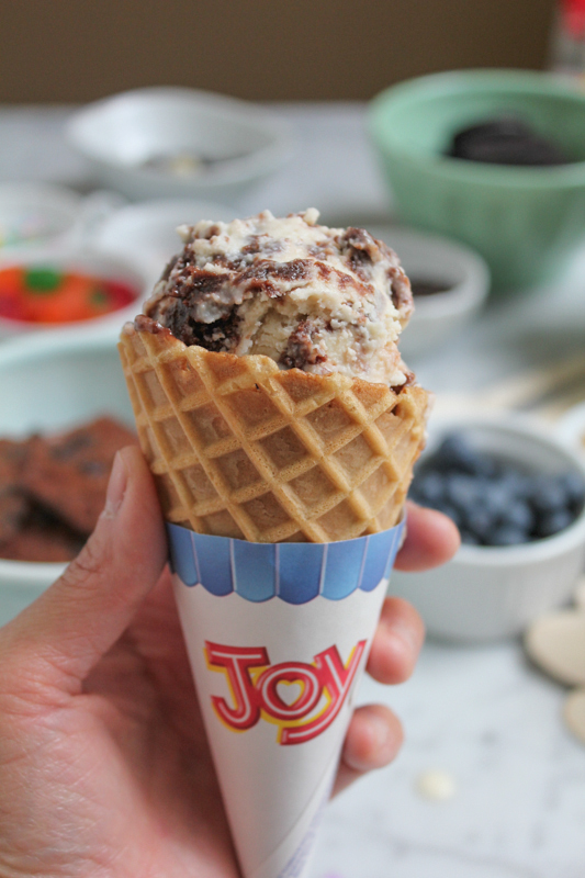 Vanilla Brownie Ice Cream with Joy Waffle Cone in hand