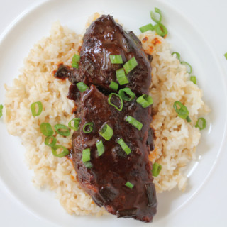 Slow Cooker Spicy Asian Beef Short Ribs!!! Literally dump everything into your crockpot, set it and forget it! So delicious!