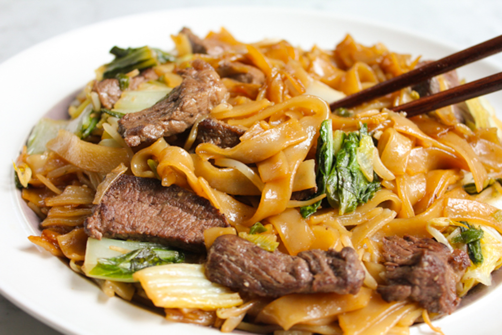 beef chow fun on white plate