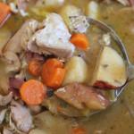 ladle of best chicken stew in pot