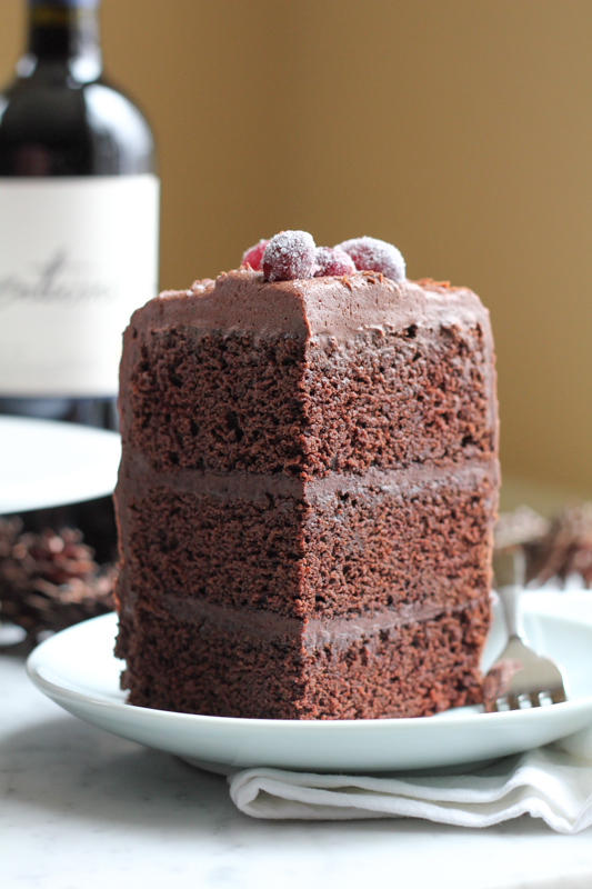 slice of frosted 3-layer homemade chocolate cake