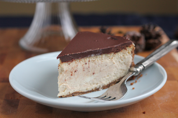 Cinnamon Eggnog Cheesecake with a gingersnap cookie crust! With hints of cinnamon, eggnog and gingerbread in each bite, you're going to love this cheesecake! #SafeNog #eggnog #holidays #baking #safeeggs #cheesecake