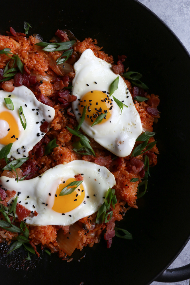 Kimchi Fried Rice Bowl (Kimchee Bokkeum Bap)!! Hot and spicy and filled with bacon bits, kimchi and topped with a fried egg. This is one of my favorite meals to eat! You've got to try this!