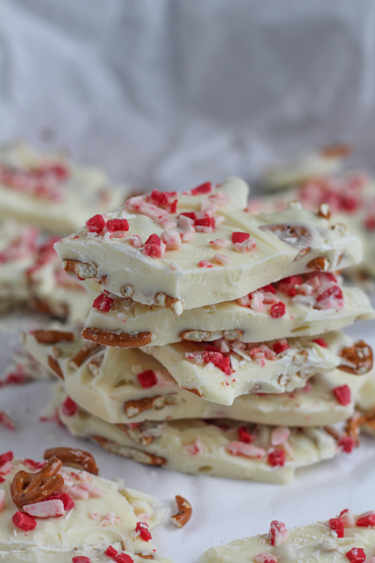 Festive white chocolate peppermint pretzel bark. Make some chocolate bark and be happy! Happy Holidays!! #chocolatebark #holidays