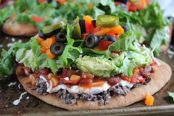 7 Layer Dip Flatbreads on baking tray.
