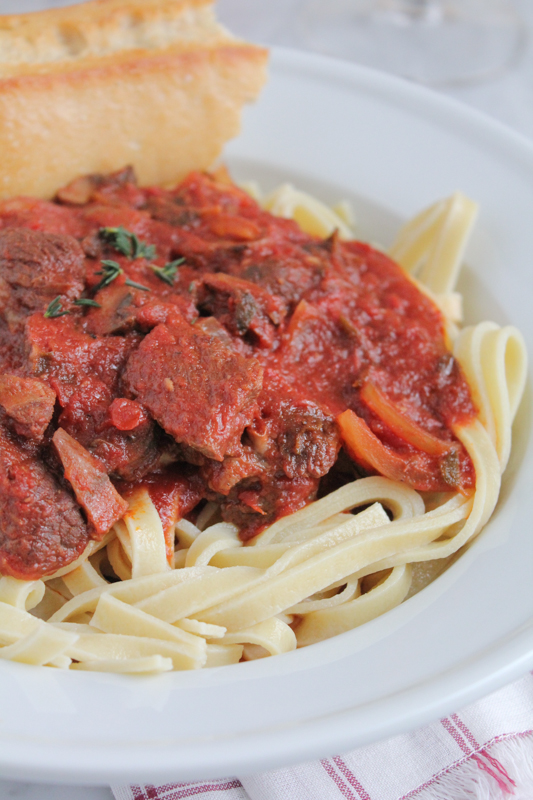The best slow cooker bolognese sauce with chunks of beef, rich in flavor and delicious! Perfect for a special night in! #valentinesday #slowcookerrecipe