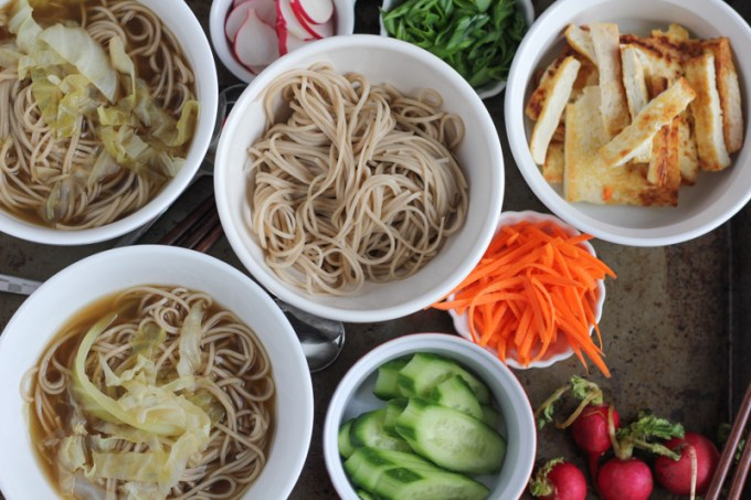 Asian Soba Noodle Broth Bowls! So delicious and easy to make! Filled with cabbage, buckwheat noodles, a light and flavorful broth and veggies for garnish, you've got to try this!