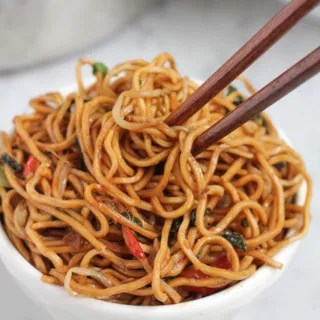 vegetable chow mein in bowl with chopsticks