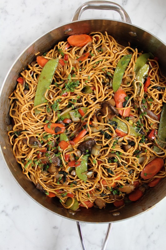 vegetable chow mein with egg noodles cooking in skillet