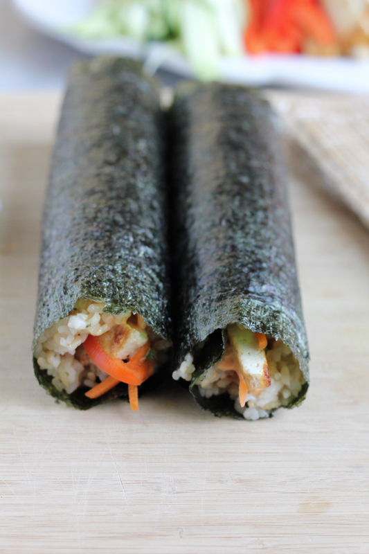 The Spicy Tofu Roll! Filled with raw vegetables and pan-fried tofu and a spicy sauce, this is the perfect spicy roll for vegetarians! #sushi #rolls #DIY #tofu #asianfood