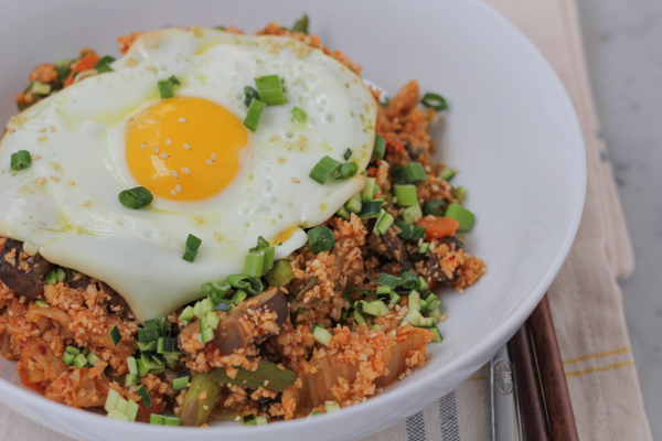 Packed with big flavors, veggies, kimchi and some heat, this Korean Style Cauliflower Rice does not disappoint! Cauliflower rice lovers, you need to try this!