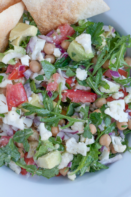 Quick, EASY to make and delicious! This raw Cauliflower and Chickpea Salad, mixed with a light and flavorful creamy lemon dressing is so good! You have to try this!