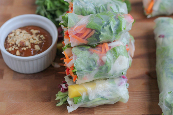 Delicious Vietnamese-style spring rolls made two ways! With fresh in-season spring vegetables and a traditional version! And don't miss out on this amazing homemade peanut sauce recipe! So easy to make! Step-by-step photos and great tutorial! #springrolls