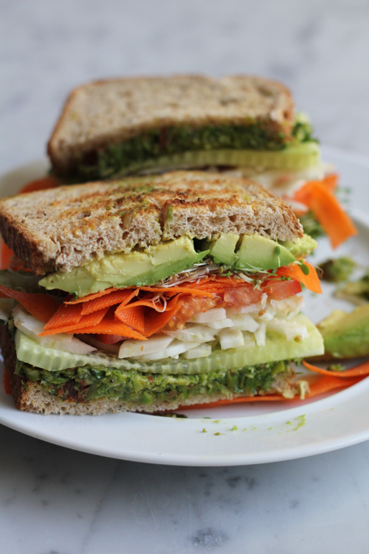 Power up with this healthy, veggie packed Vegan Power Sandwich with Asparagus Pesto! Fresh, filling and flavorful, this veggie sandwich will not disappoint! #vegan #vegetarian #healthy #vegansandwich