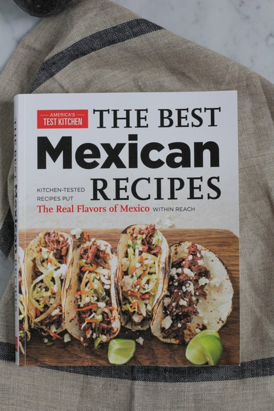 Cookbook with Corn and Black Bean Tortilla Tart recipe.
