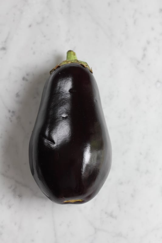 An eggplant for Grilled Eggplant Bun Burger.