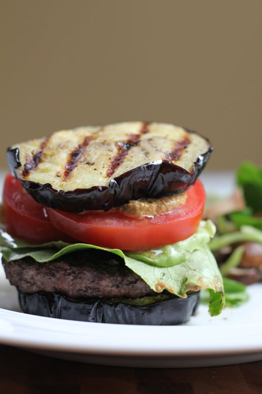 A plate with a Grilled Eggplant Bun Burger.