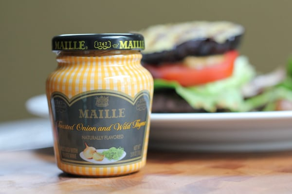 A jar of mustard for Grilled Eggplant Bun Burgers.