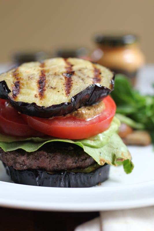 A Grilled Eggplant Bun Burger on a white plate.