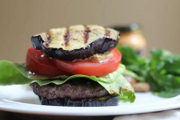 Grilled Eggplant Bun Burger on a plate.