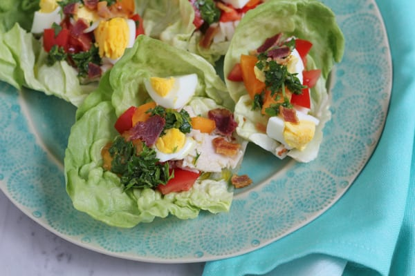 A plate of Cobb Salad Lettuce Wraps.