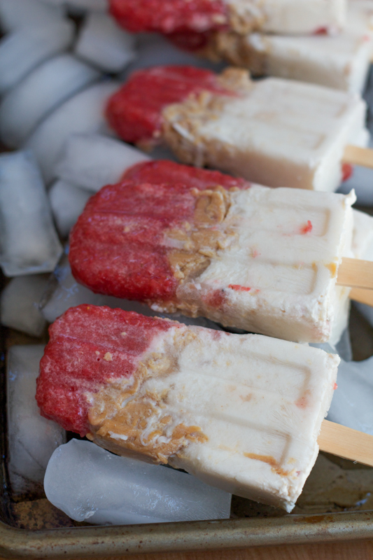 Cool down this summer with something delicious! If you like peanut butter, you will love these Strawberry Coconut and Peanut Butter popsicles! This flavor combo works so well together. You have to try this!