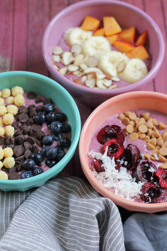 Berry Smoothie Breakfast Bowls. Easy to make and loaded with fruit, texture and nutrients! Customize these bowls for each member of the family!! #breakfast #smoothies