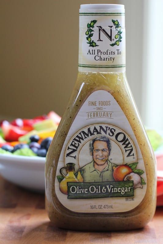 A bottle of vinaigrette for Summer Berry Salad.