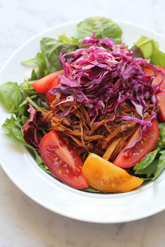 Barbecue Pulled Chicken Salad! Fresh, flavorful and your slow cooker does all the work for you! This is the perfect meal! Make a salad or sandwich or eat this with mashed potatoes! You can't go wrong! #slowcooker #crockpot