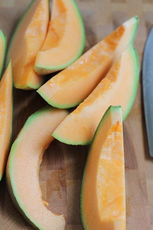 Sliced cantaloupe for Simple Cantaloupe Salad.