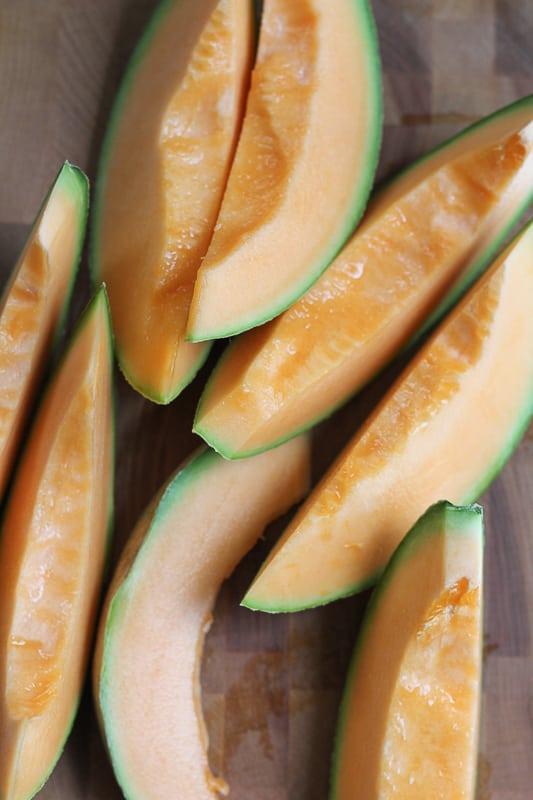 Slices of cantaloupe for Simple Cantaloupe Salad.