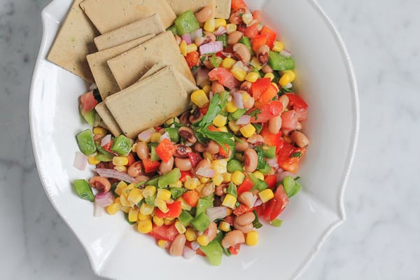 Texas Caviar in a bowl with crackers.