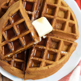 Gingerbread Pumpkin Waffles! Richly spiced with cloves, nutmeg, cinnamon and ginger, these waffles get an additional boost of flavor from finely diced candied ginger. Don't miss these waffles!