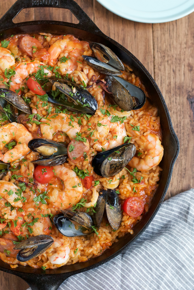 Seafood Paella recipe being made in black paella pan