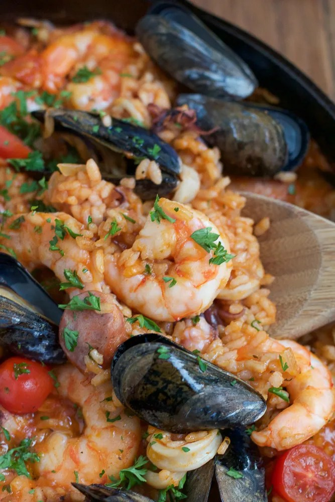 seafood dinner with shrimp, mussels, tomatoes and rice
