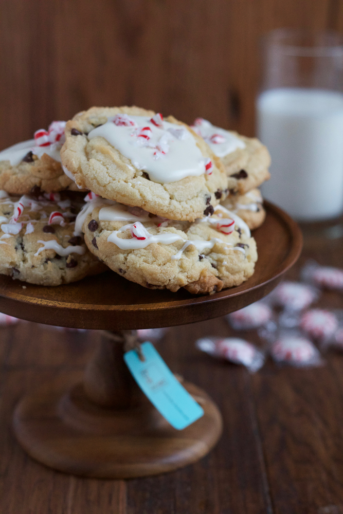 peppermint glazed holiday cookies on wooden platter
