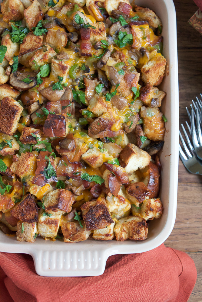 Hot and Spicy Cheesebread Stuffing with Jones Bacon!! Made with hot and spicy cheesy bread, Jones Dairy Farm Dry Aged Bacon, cremini mushrooms, cheddar cheese and more! This stuffing is absolutely delicious!!